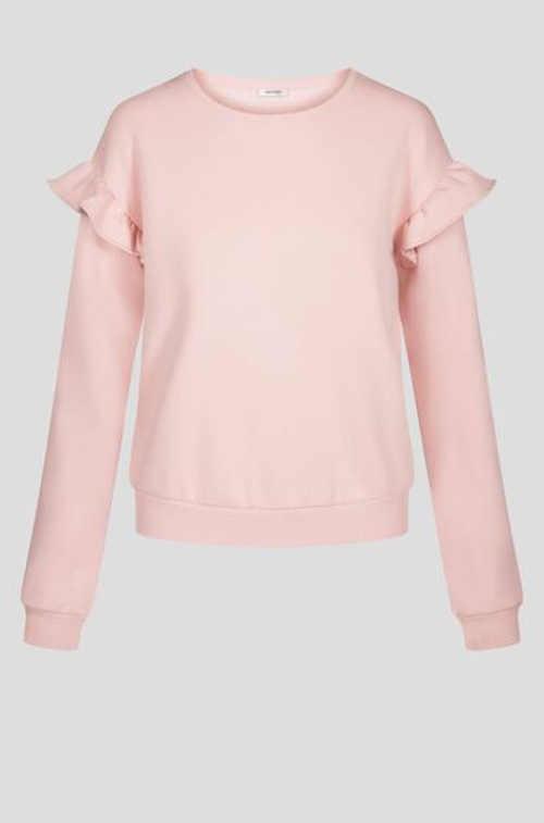 růžové triko s volánky na rukávech